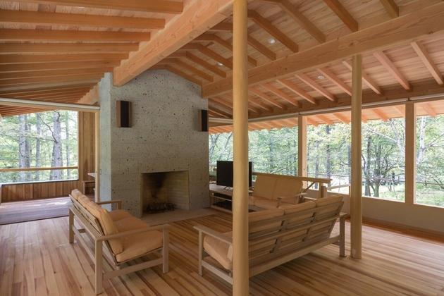 8-concrete-plinths-elevate-woodland-house-bridge.jpg