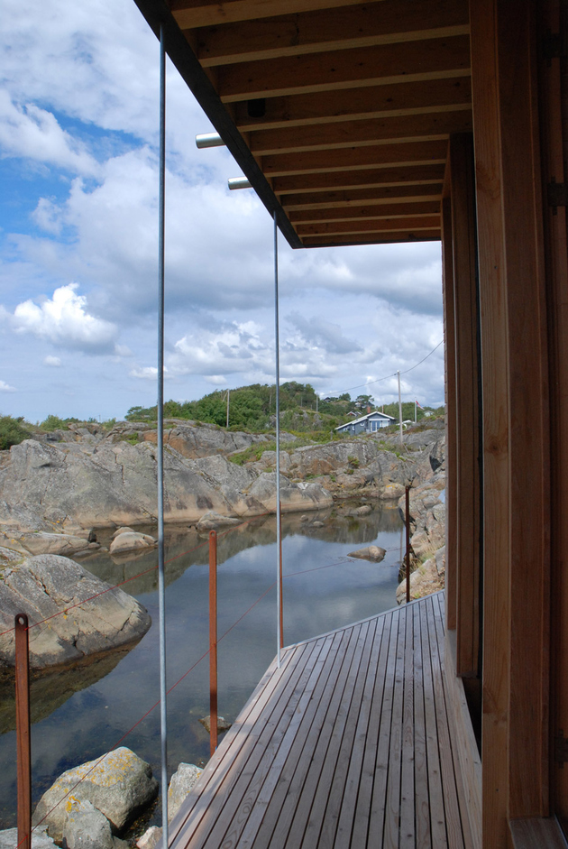 13-boat-access-only-75sqm-summer-cabin-straddles-boulders.jpg