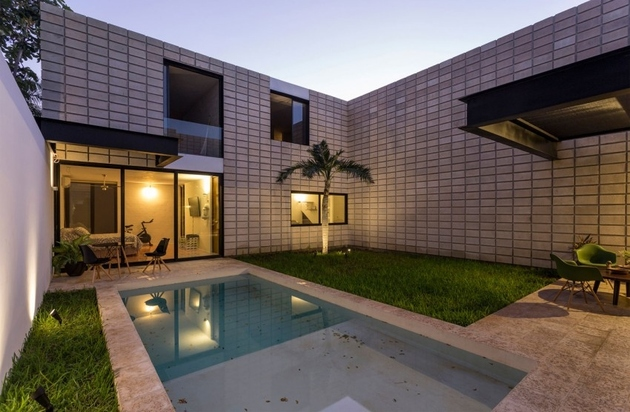 14-c-shaped-concrete-block-home-swimming-pool-courtyard.jpg