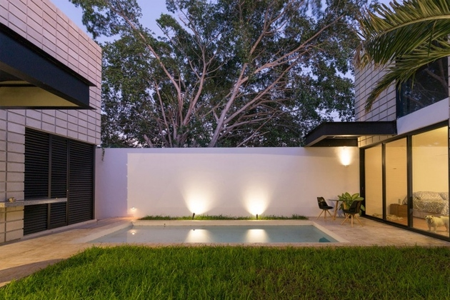 15-c-shaped-concrete-block-home-swimming-pool-courtyard.jpg