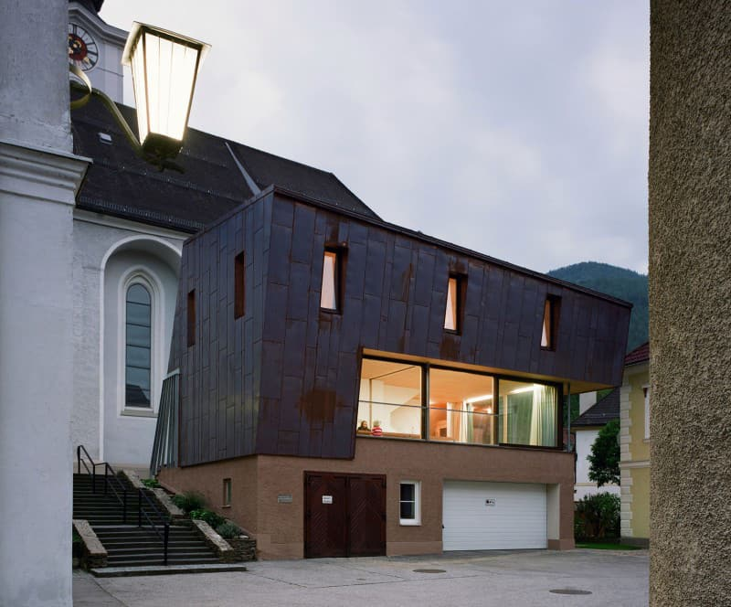 Austrian house with copper exterior and slanted shape