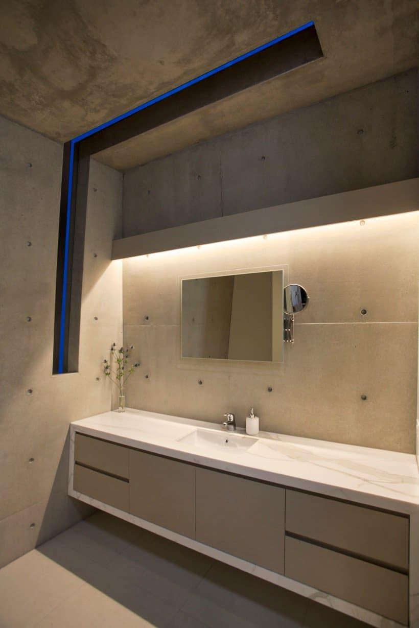 Bold exterior beach house with minimalist interiors for Minimalist interior design bathroom