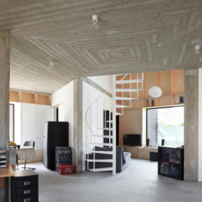 Belgium Angle House with Concrete, Wood and Brick Interiors