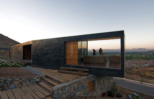 binimelis house 6 Stone House Design in Chile   contemporary on the slope