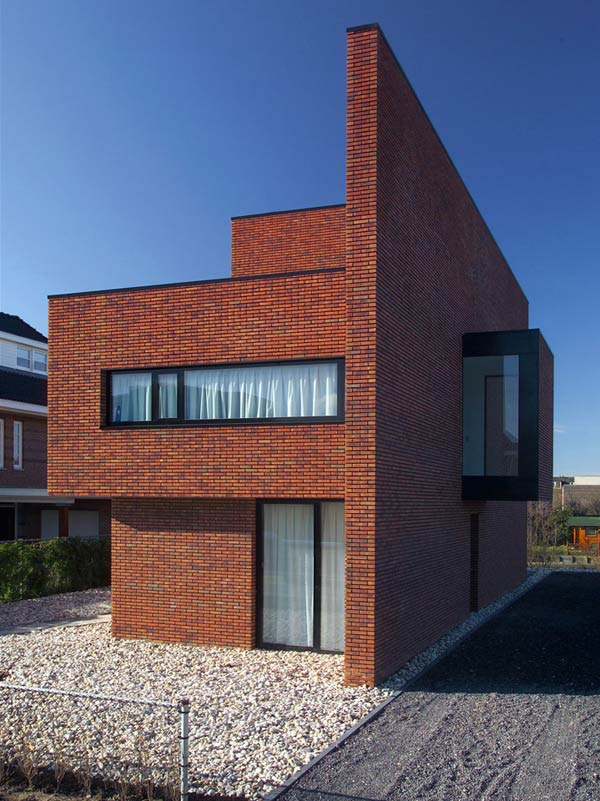 Brick wall house boasts minimalist style with maximum appeal for Brick house design blog
