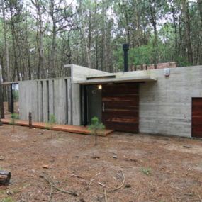 Vacation House Design – rustic concrete cottage built for minimal maintenance