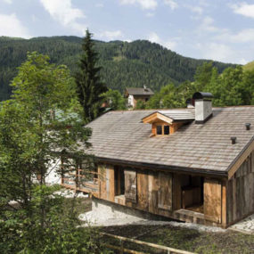 Modern stone cabin in northern italy is a romantic gem for Italian country home plans