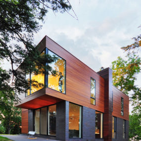 Compact cantilevered house in historic hood
