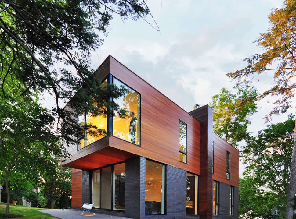 Compact cantilevered house in historic hood for Cool house designs