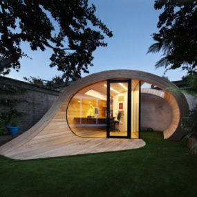 Compact Curled Wood House makes a sculptural, functional garden feature