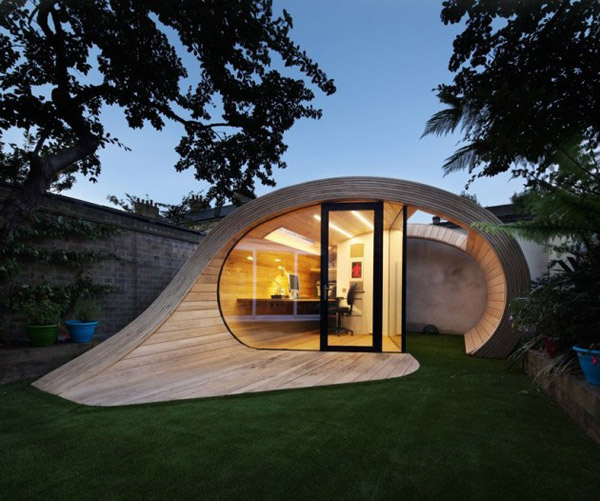 compact curled wood house 1 Compact Curled Wood House makes a sculptural, functional garden feature