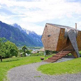 Compact Austrian Mountain House On Stilts