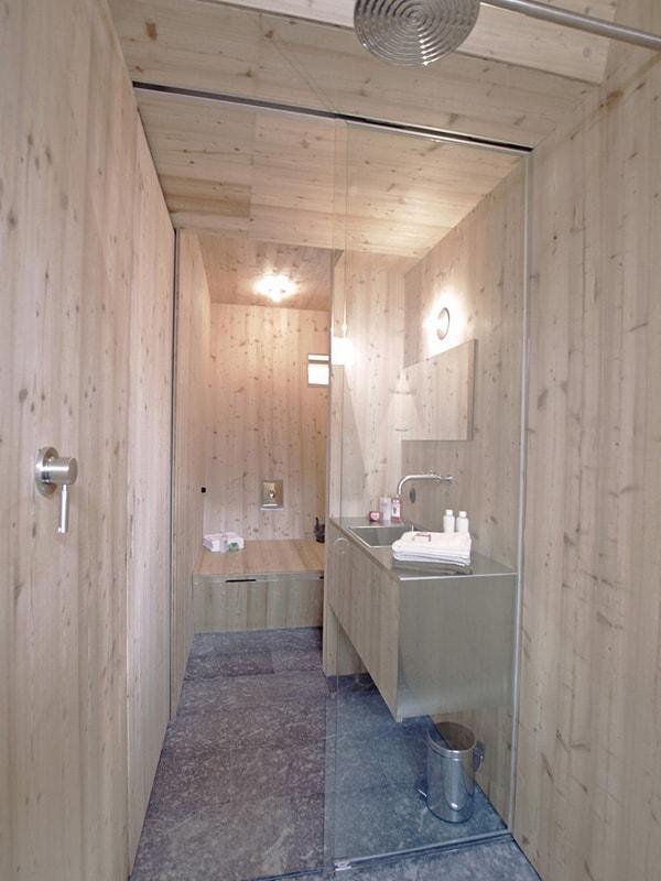 compact-irregularly-shaped-austrian-mountain-house-on-stilts-19-bathroom-inward.jpeg