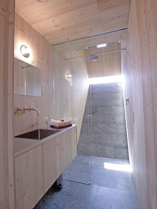 compact irregularly shaped austrian mountain house on stilts 21 bathroom outward