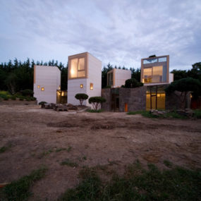 Concrete Tower House: Minimalist Living, Warm Aesthetic