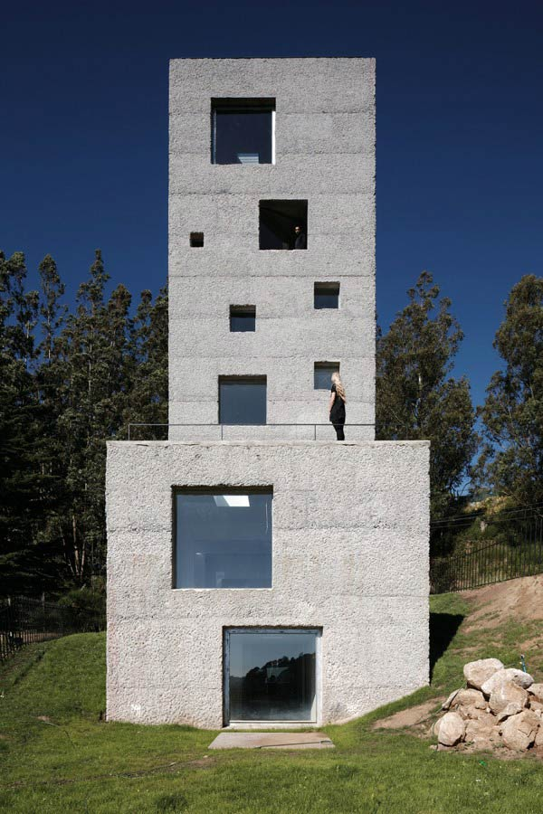 Concrete tower house designed with live work space for Tower home plans