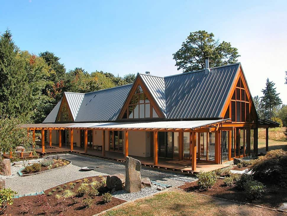 Cabin chic mountain home of glass and wood for High pitched roof house plans