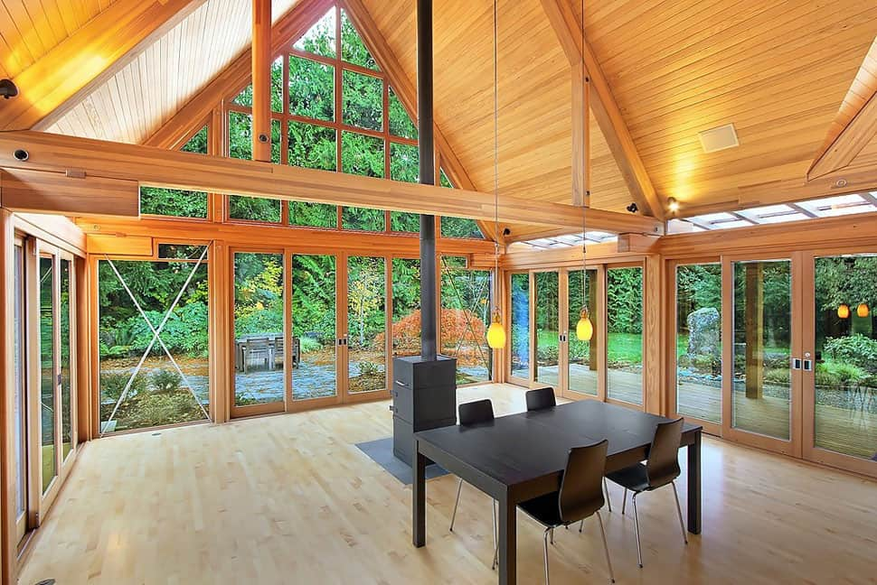 Cabin chic mountain home of glass and wood for Home plans with vaulted ceilings