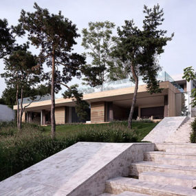 Contemporary concrete house with two verandas and no windows