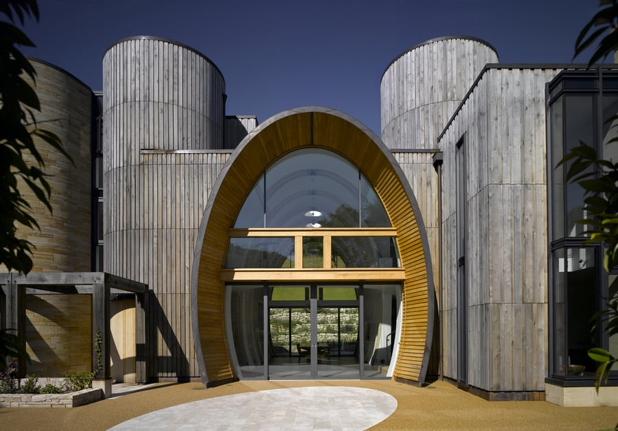 Contemporary Countryside Home with Oval Entrance and Interior Glazing