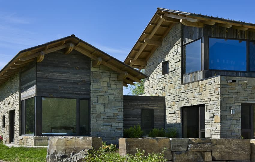 View In Gallery Contemporary Stone Farmhouse With Aged Wood Siding Segments