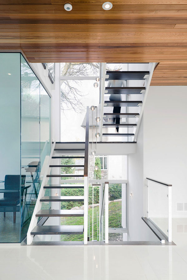 contemporary-style-house-designed-with-glass-walls-riverfront-views-13.jpg