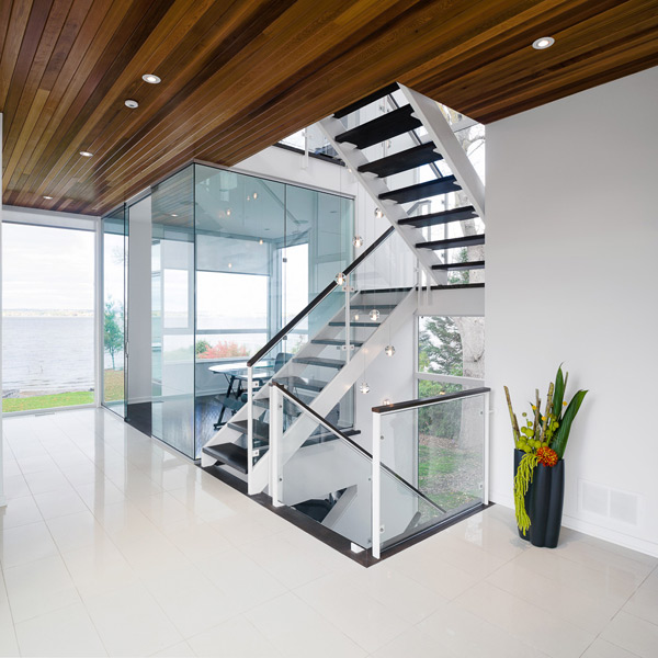 contemporary-style-house-designed-with-glass-walls-riverfront-views-6.jpg