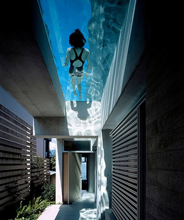 cool concrete house with hot swimming pool feature above main entrance - Cool House Pools