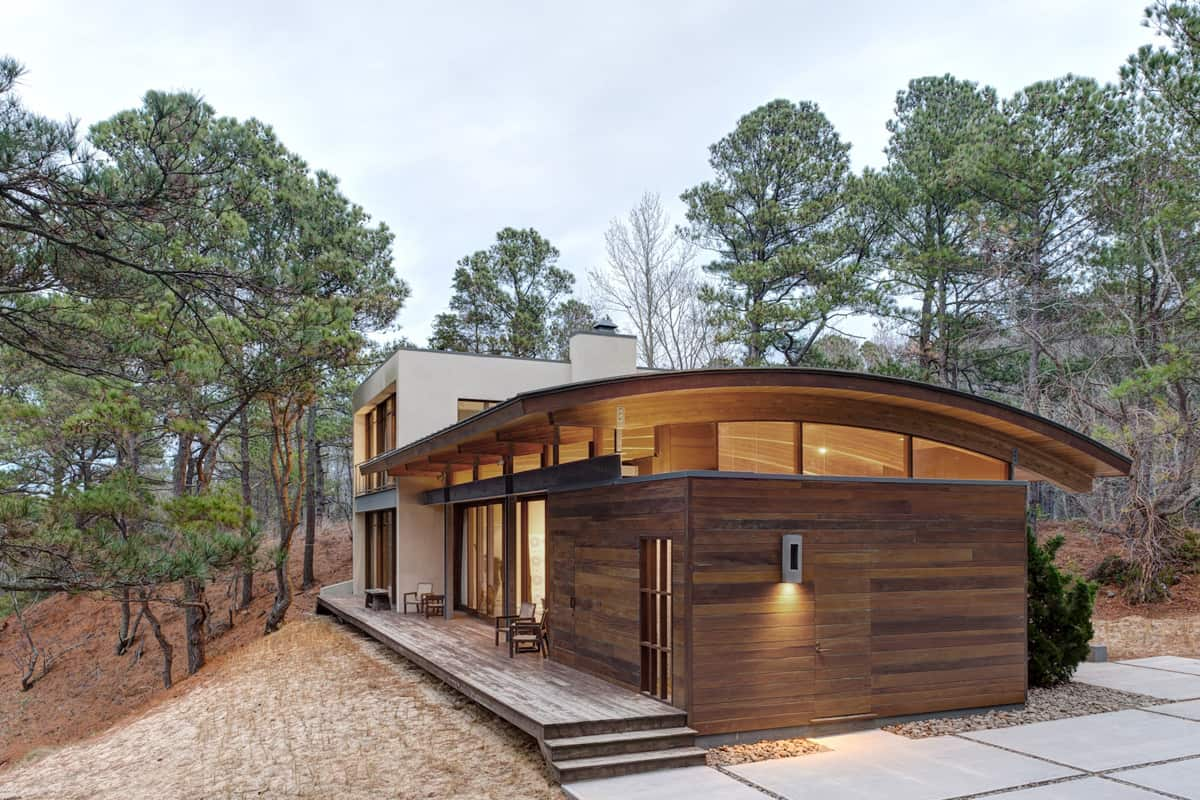 Contemporary forest house with curved metal roof for Natural home plans