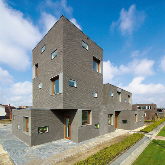 Brick House Design in Netherlands – asymmetrical, with two faces