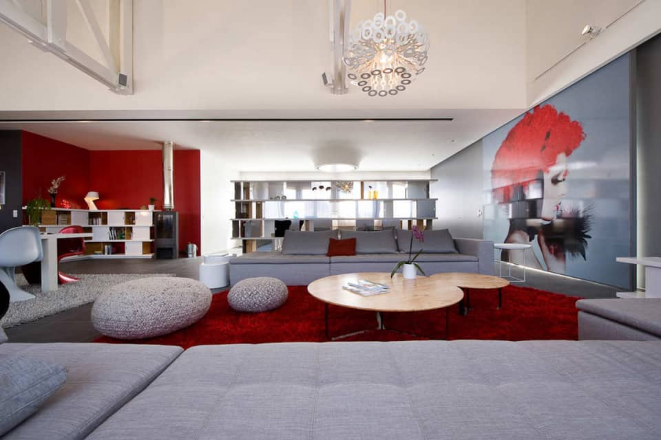 Fashionable French Loft with Open Interiors and Colorful Lighting