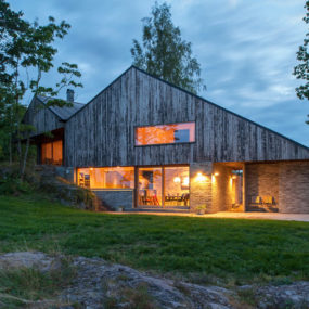 M Shaped Roof Fjord House Clad in Weathered Wood