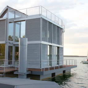 Floating Lake House Inspired by Sailboats