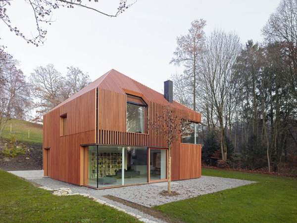 House Clad in Wood Lamella