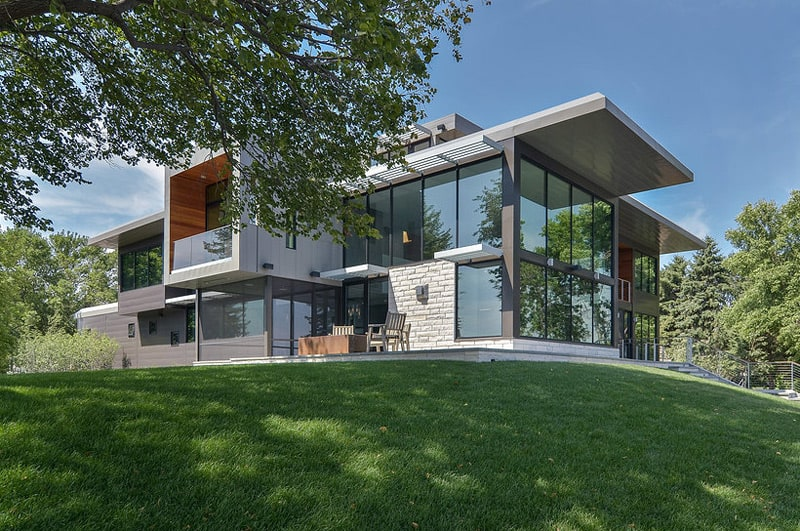 Glass Lake House Features Modern Silhouette of Earthy ... on Glass House Design Ideas  id=18312