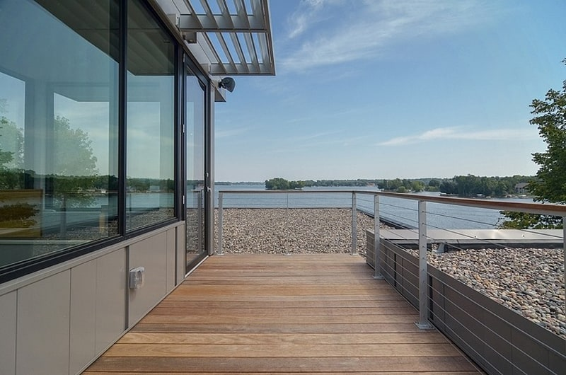 View in gallery glass lake house features modern silhouette of earthy