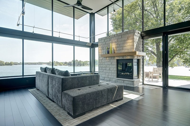 Glass Lake House Features Modern Silhouette of Earthy Materials