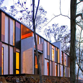 Colorful Lake House built into slope