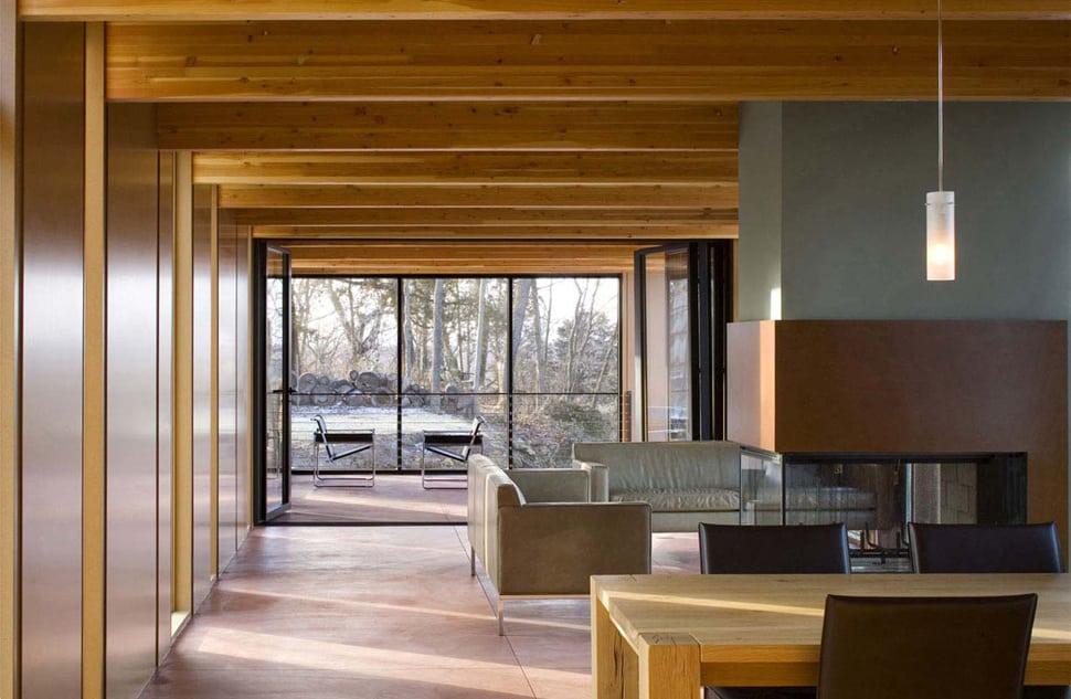 colorful lake house built into slope. Black Bedroom Furniture Sets. Home Design Ideas