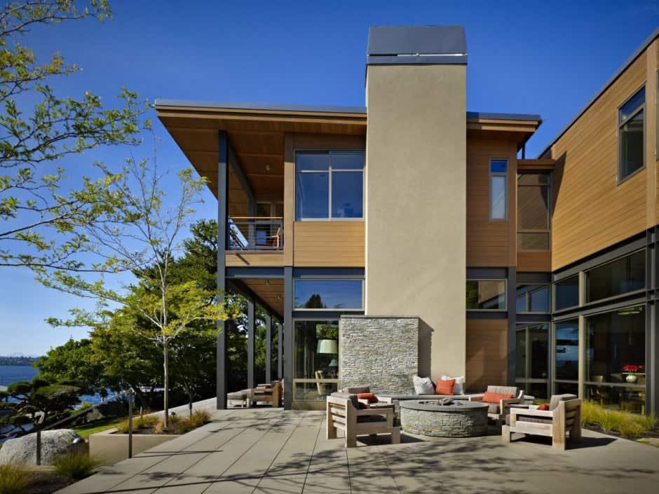 Grand glass lake house with bold steel frame   Modern ...