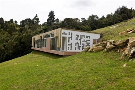 Hillside home design with roof entrance for Modern hillside house plans