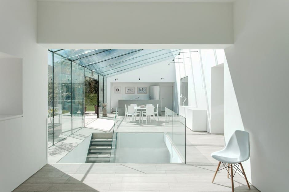 View in gallery historic-brick-house-with-modern-glass-wing-and-