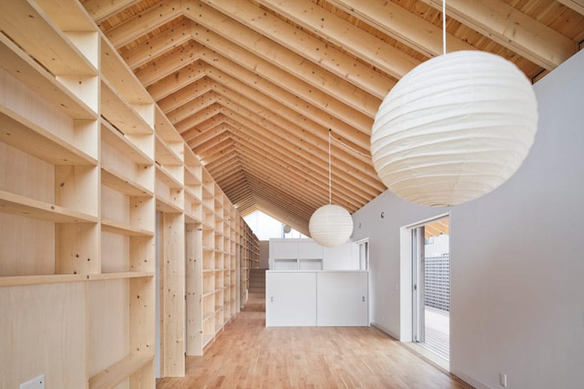 House With Exposed Timber Rafters And Bookshelf Columns