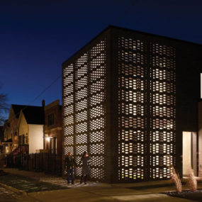 House with Woven Brick Screen Enclosing Home and Garden