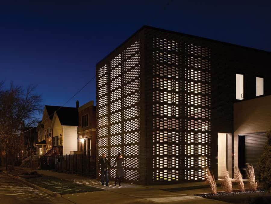 House with Woven Brick Screen Enclosing Home and Garden