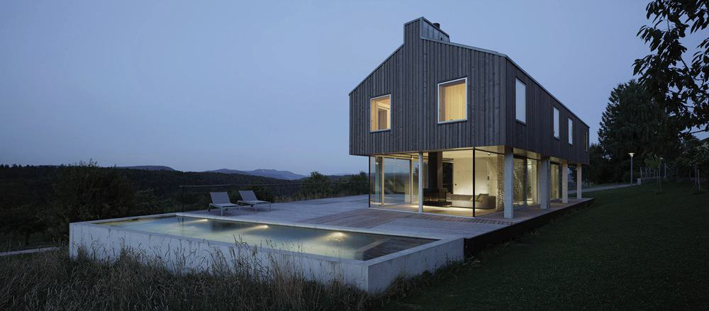 Isolated Swiss Countryside Home With Glass Encased Lower Floor