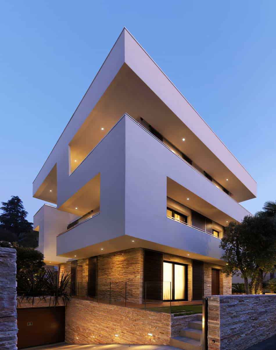 Italian maze house with geometric exterior, sliding interior walls