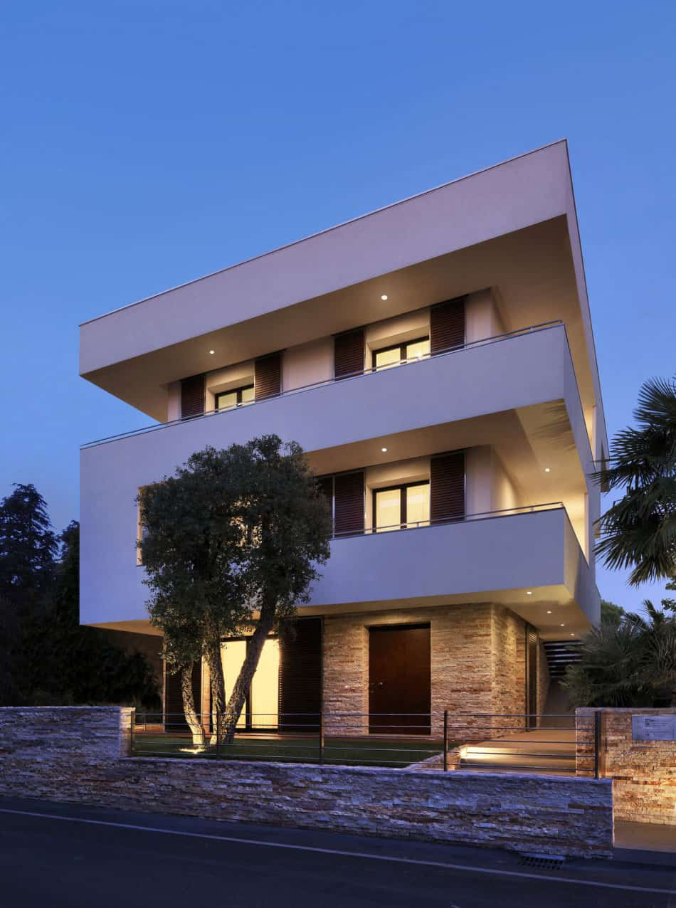 Italian maze house with geometric exterior, sliding ...
