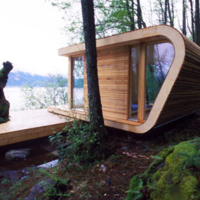 Lake House Architecture with Modern Wraparound Roof