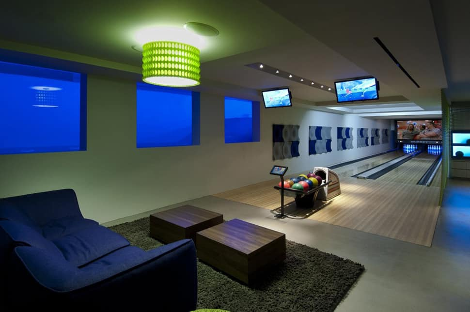 View In Gallery Luxury Family Home With Transpa Walls And Bowling